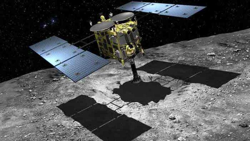 Artystyczna wizja Hayabusa 2 lądującego na powierzchni planetoidy (JAXA)